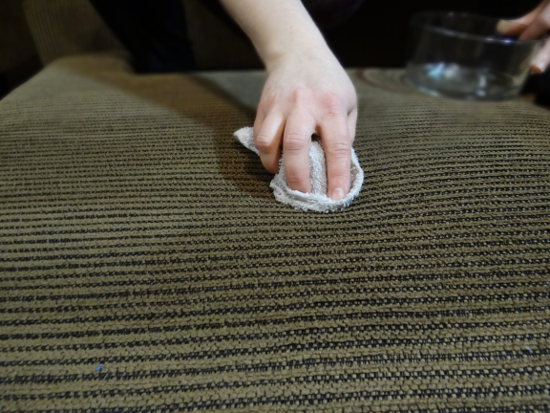 wiping-couch-with-vinegar-rag